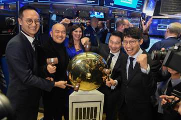 Cussion Kar Shun Pang, CEO of Tencent Music Entertainment with the company's leadership team rings a ceremonial bell to celebrate company's IPO on the floor of the New York Stock Exchange (NYSE) in New York