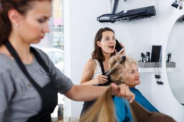 Hairstylist having phone conversation