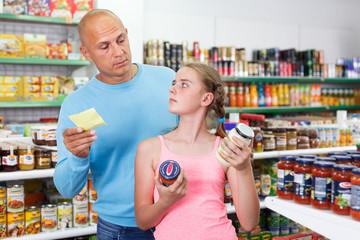 man and girl selecting food