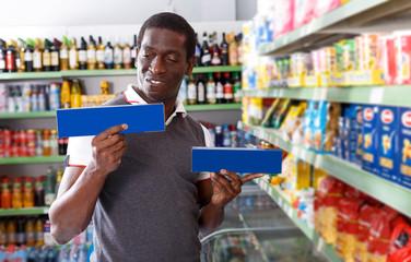 African man choosing pasta