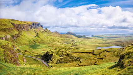 Panoramic aerial view of Quiraing and Staffin Bay on Isle of Skye, Scotland. Copy space in blue sky.