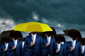 hands yellow and black umbrella