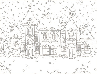 Small houses of a toy town in a snowy winter day, black and white vector illustration in a cartoon style for a coloring book