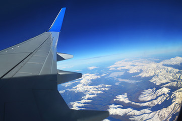 The view from the window of an airplane over the mountains of the Caucasus