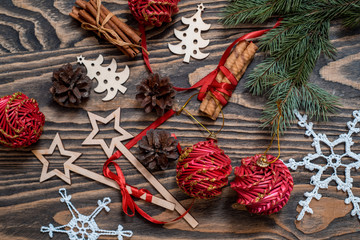 Christmas background with Christmas gift, pine cones, red decorations on wooden background with Fir branches. Xmas and Happy New Year composition. Flat lay, top view