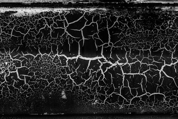 Background of old cracked paint. Large cracks on the surface. Close the layers; many paint and...