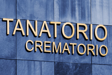 funeral home and crematorium service building, spanish language sign