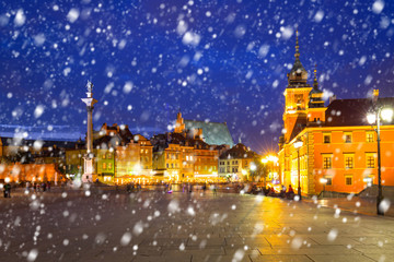 Old town of Warsaw on a cold winter night with falling snow, Poland