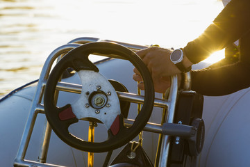 Men's hands on a motor boat