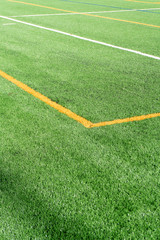 Soccer field with new artificial turf field. Close up. Soccer background. Copy space