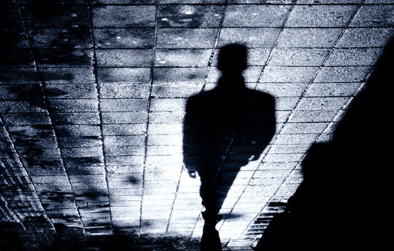 Blurry one man alone in the night shadow