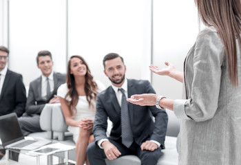 business woman makes a presentation for the business team.