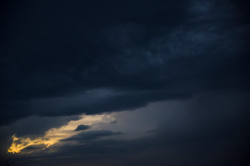 sunset behind storm clouds