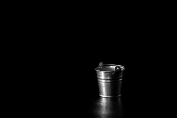 old retro Metal bucket on black background