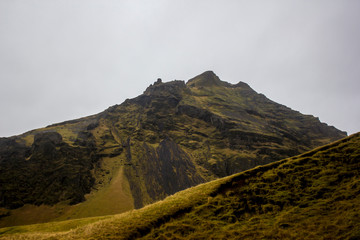 Beautiful Rocky Mountains of Volcanic Rock Covered in Gold and Green Grasses in the Golden Circle of Iceland