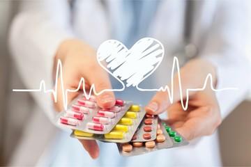 Pills in female hands