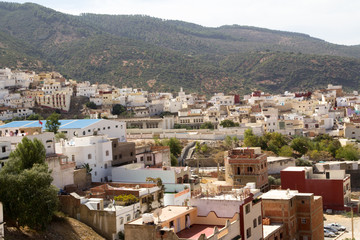 Africa, Northern Morocco, Rif Mountains, local village houses perched on hillside.
