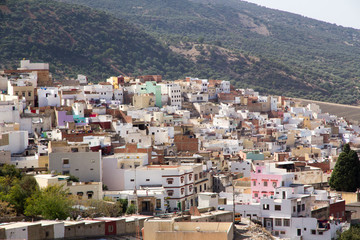 Africa, Northern Morocco, Rif Mountains, colorful,local village houses perched on hillside.
