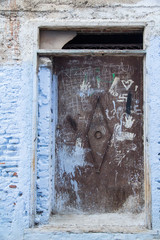 """Africa, North Africa, Chefchaouen, """"The Blue City"""", situated in the heart of Morocco's Rif Mountains and located in northeastern Morocco near the Mediterranean Sea. Graffiti in doorway."""