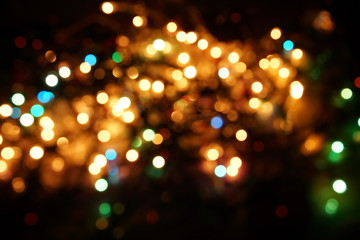 natural bokeh holiday lights background bright lights green yellow blue party city