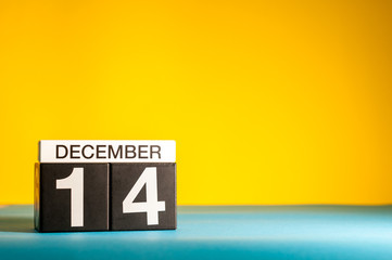 December 14th. Image 14 day of december month, calendar on yellow background with empty space for text