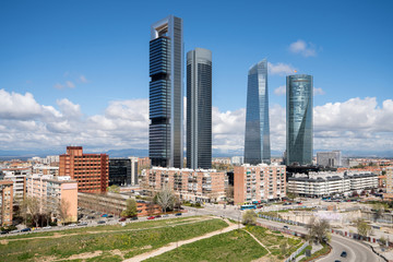 Madrid cityscape at daytime. Landscape of Madrid business building at Four Tower. Modern high building in business district area at Spain. Wall mural