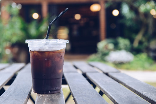 Iced Americano serving on the wood table.