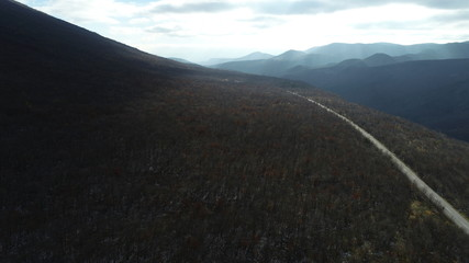 aerial view of country road on early winter