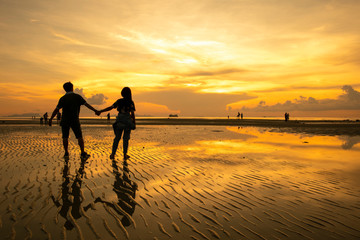 Silhouette of couple lover on the beach