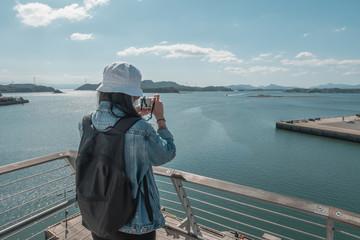 Woman take photo on the top of Misumi Port Umi no Pyramid, Pyramid of the Sea, Misumi, Kumamoto, Kyushu, Japan
