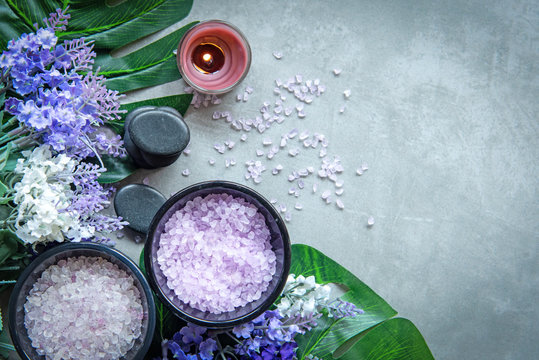 Lavender aromatherapy Spa with candle and rock spa. Thai Spa relax Treatments and massage concrete background. Healthy Concept. Top view and Copy space for text.