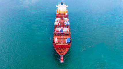 Aerial view container ship, Carrying container for import export business logistic and transportation of International by freight cargo ship in the open sea.