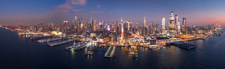 Aerial panorama of the entire Manhattan island at dusk