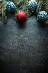 Top of view christmas balls fir tree pine cones on free concrete background