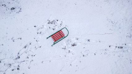 sled in the snow view from the quadcopter