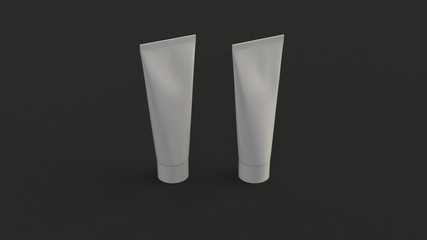 Pair of blank white tubes of toothpaste, cream or gel