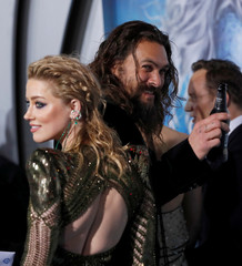 "Cast members Momoa and Heard attend the premiere for ""Aquaman"" in Los Angeles"