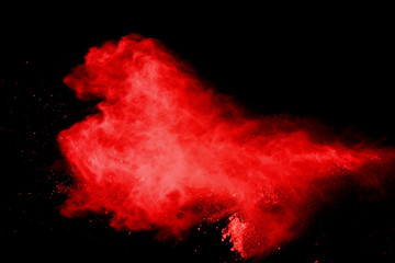 red powder explosion isolated on black background