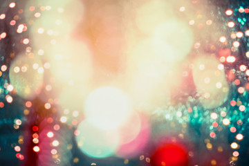 Festive holidays lighting bokeh on colorful event background, frame with copy space