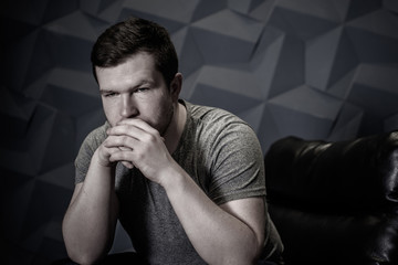 Man in sadness or depression, grief and bad mood. Psychology problems among men. Image sad guy thinking about something