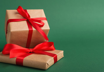 Christmas style rustic brown paper package with ribbons