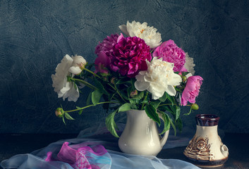 Still life with white and pink peonies.