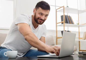 Successful entrepreneur working on laptop in home office.