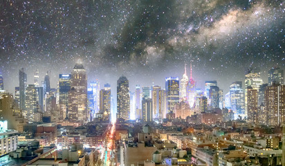 Midtown Manhattan aerial view at night as seen from Hell's Kitchen rooftop with starry night