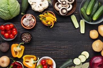 Fresh healthy vegetables on dark rustic wooden table