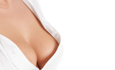 Beautiful woman breast. Perfect breast of young woman in white shirt close-up. Isolated over white background