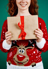 Close up of woman holding christmas present