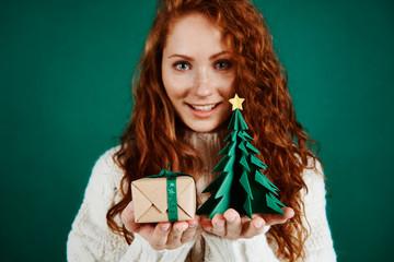 Happy girl giving christmas present