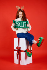 Young woman with banner of winter sale
