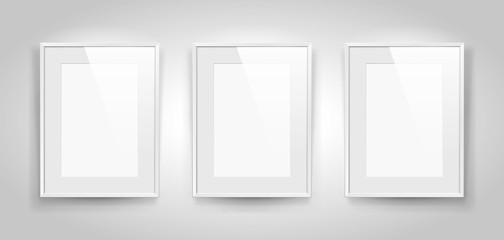 Three realistic empty rectangular white frames with passepartout on gray background, border for your creative project, mock-up sample, picture on the wall, vector design object